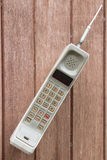 Mobile phone on brown wood background. Stock Photography