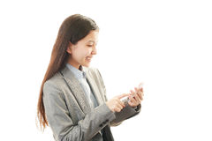 Mobile phone and business woman. Royalty Free Stock Images