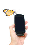 Mobile phone and butterfly Royalty Free Stock Images