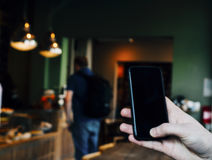 A mobile phone in the cafe Royalty Free Stock Photo