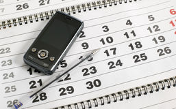 Mobile phone on the calendar Royalty Free Stock Photos