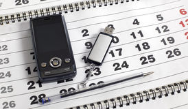 Mobile phone on the calendar Stock Photo