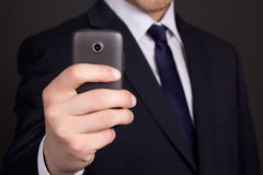 Mobile phone with camera in business man hand Royalty Free Stock Images