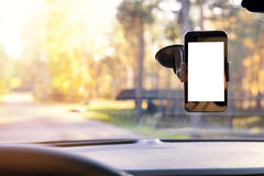 Mobile phone in car windshield holder Royalty Free Stock Photo