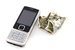 Mobile phone and cash. Isolated on white Royalty Free Stock Photography