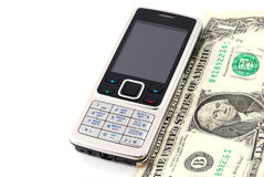Mobile phone and cash. Isolated on white Stock Image