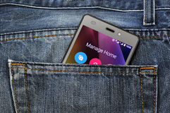 Mobile phone, cellphone in back pocket blue jeans Royalty Free Stock Photo