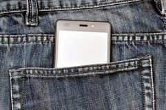 Mobile phone, cellphone in back pocket blue jeans.  Royalty Free Stock Photos