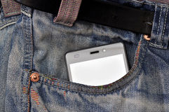 Mobile phone, cellphone in pocket blue jeans.  Royalty Free Stock Images