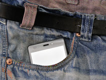 Mobile phone, cellphone in pocket blue jeans.  Stock Images