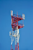 Mobile phone cellular telecommunication radio antenna tower. Cell phone tower against blue sky Stock Photography
