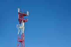 Mobile phone cellular telecommunication radio antenna tower. Cell phone tower against blue sky Royalty Free Stock Image