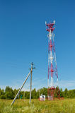 Mobile phone cellular telecommunication radio antenna tower. Cell phone tower against blue sky Stock Images