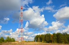 Mobile phone cellular telecommunication radio tv antenna tower against blue sky Royalty Free Stock Photos