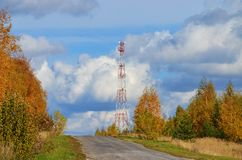 Mobile phone cellular telecommunication radio tv antenna tower against blue sky Royalty Free Stock Photography