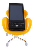 Mobile phone on the chair. Black mobile phone on yellow chair isolated on white background stock images