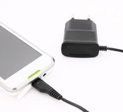 Mobile phone charger. Close-up Mobile phone charger on a white background Stock Photo