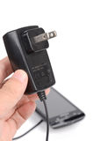 Mobile phone and charger Stock Image