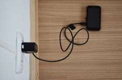Mobile phone and charger Royalty Free Stock Images