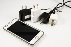 Mobile phone and chargers Stock Photography