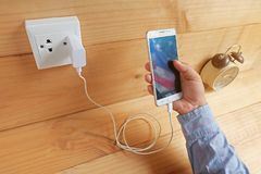 Mobile phone and charging royalty free stock photo