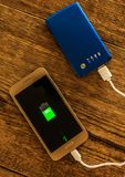 Mobile phone charging Royalty Free Stock Photos