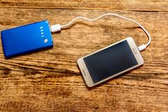 Mobile phone charging Stock Photo