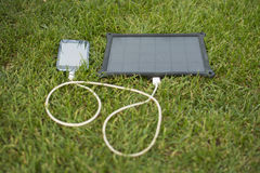 Mobile phone charging with solar energy - charger Stock Photo