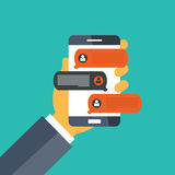 Mobile phone with chat message notifications. Hand holding smart phone and chatting bubble speeches. Mobile phone with chat message notifications. Concept of on Royalty Free Stock Images