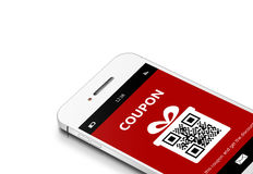 Mobile phone with christmas coupon over white. Mobile phone with discount coupon isolated over white background Royalty Free Stock Images