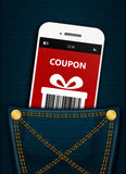 Mobile phone with christmas coupon in pocket Royalty Free Stock Photos