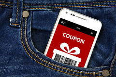 Mobile phone with christmas coupon in pocket Stock Photo