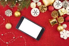Mobile phone and the Christmas decoration stock photos