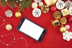 Mobile phone and the Christmas decoration Stock Photography