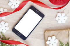 Mobile phone and the Christmas and New Year decoration Royalty Free Stock Photography