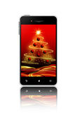 Mobile phone with christmas screen over white background Stock Photo