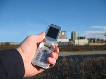 Mobile phone clear blue sky Stock Photography
