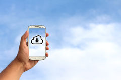 Mobile phone in the cloud. Cloud icon on a mobile phone on sky background Stock Image