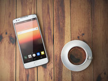 Mobile phone and coffee cup on wooden background. Royalty Free Stock Image