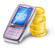 Mobile phone and coins. Stock Photo