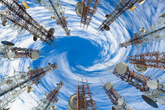 Mobile phone communication antenna tower with cloud and blue sky Royalty Free Stock Photography