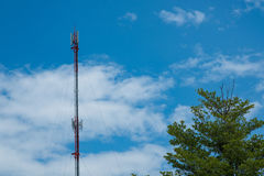 Mobile phone communication antenna tower with cloud on center bl Royalty Free Stock Photo