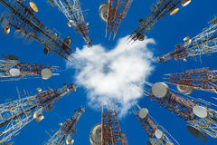 Mobile phone communication antenna tower with heart shape cloud Stock Images