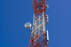 Mobile phone communication antenna tower with satellite dish on Royalty Free Stock Photos