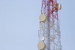 Mobile phone communication tower transmission with blue sky back Stock Photo