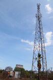 Mobile phone communication tower transmission signal with blue sky and antenna Royalty Free Stock Image