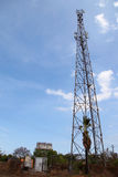 Mobile phone communication tower transmission signal with blue sky and antenna Royalty Free Stock Images