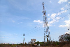 Mobile phone communication tower transmission signal with blue sky and antenna Stock Images