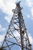Mobile phone communication tower transmission signal with blue sky and antenna Stock Photo
