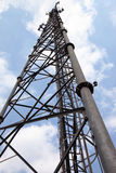 Mobile phone communication tower transmission signal with blue sky and antenna Stock Image